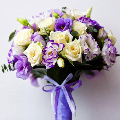 Букет невесты из желтых роз и эустомы