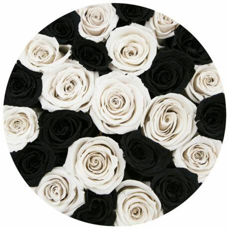 Черные и белые розы в шляпной коробке (сверху)